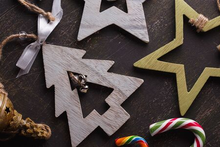 Decorative wooden pendants with bells. Top view of a Christmas decoration with candy