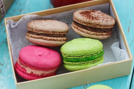 Macaroon cakes in a box, closeup