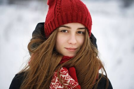 Beautiful girl posing winter day. Portrait of a teenager looking enigmatically into the camera, close-up Stock Photo