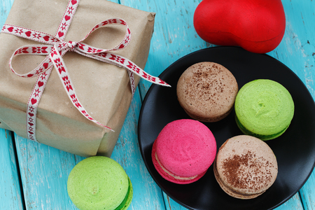 Macaroon cakes in a box and gift, close-up