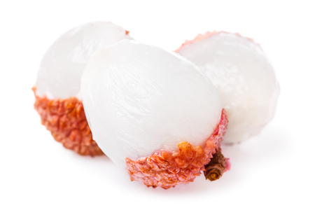 Three Chinese lychee isolated on white background, close-up