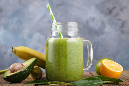 Smoothies of avocado, banana, citrus and spinach leaves Stock Photo