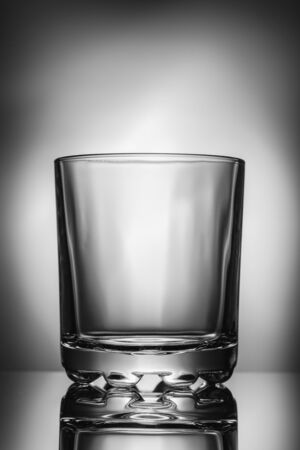Empty glass on a reflective surface