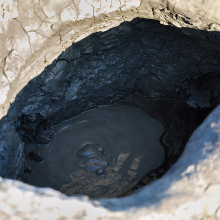 Process of boiling a mud volcano. The resulting mass is useful for health and is used in medecine