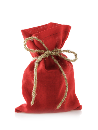 Bag of red color full of gifts for new year, isolated on white background Stock Photo
