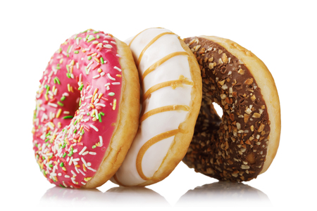 Three fresh donuts with various fillings isolated on white background Stock Photo