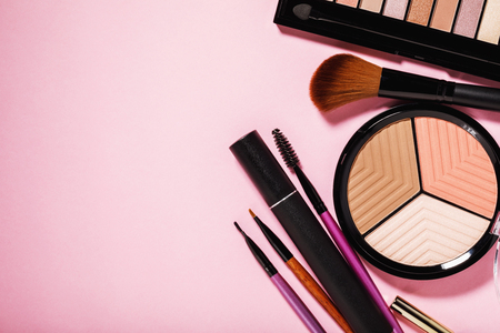 Make-up tools, including sculptor, blush and highlighter with copy space, top view
