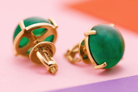 Beautiful gold earrings with agate, close-up 写真素材