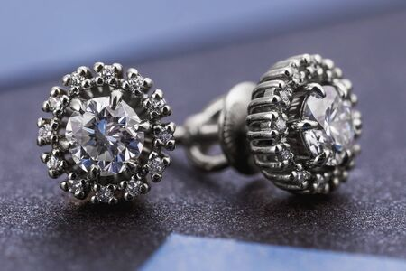 Beautiful white gold and diamond earrings, close-up 写真素材