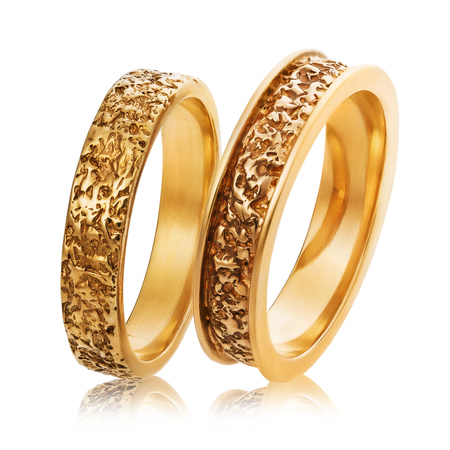 Two gold wedding rings isolated on white background. The photo was taken by stacking