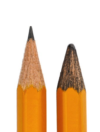 Two graphite pencils, one is new, the other is old, isolated on white background