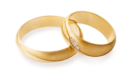 Gold wedding rings with diamonds isolated on white background. The photo was taken by stacking.