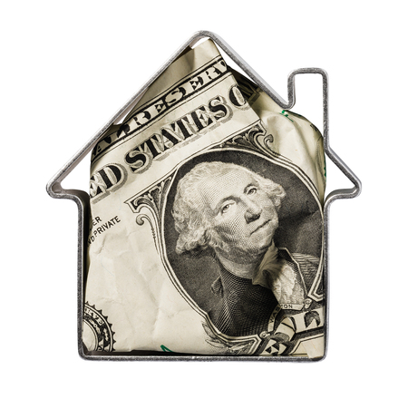 Dollar inside metallic shape resembling a house isolated on a white background. Concept on the topic of financial transactions with real estate 写真素材