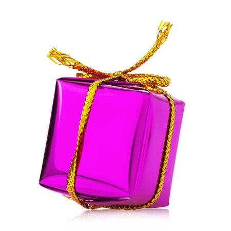 Gift in a box tied with a golden ribbon isolated on white background