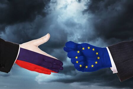 Hands on sky background. Concept on the topic of the proposal of friendship and relations between states Фото со стока