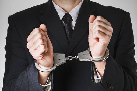 Handcuffed deputy, close-up. Concept on the topic of arrest for corruption