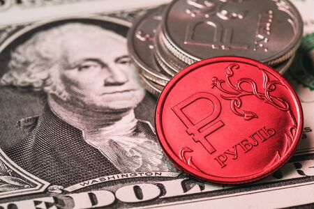 Russian ruble against the backdrop of the american dollar, close-up. The concept on the topic of reducing the currency Stock Photo