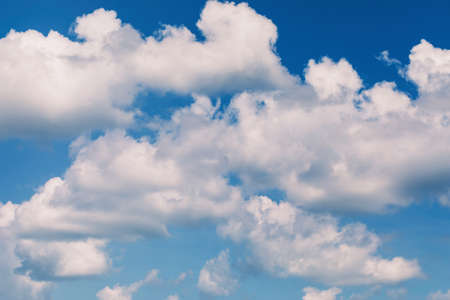 A fragment of white clouds in the blue sky in defocus for use as a background