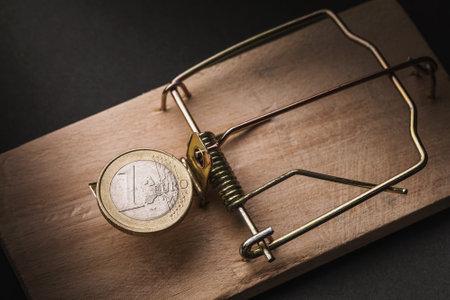 One euro in a mousetrap. Financial trap concept.