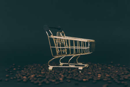 Cart for a supermarket on a background with coffee beans Stok Fotoğraf