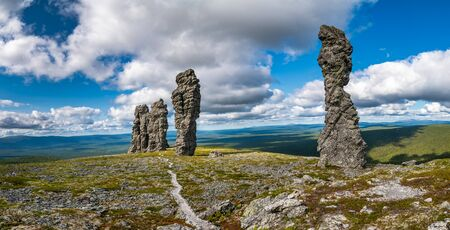 set of 7 stone pillars located west of the Ural mountains in the Troitsko-Pechorsky District of the Komi Republic 写真素材 - 129464032