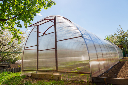 Greenhouse polycarbonate is in the garden Stock Photo