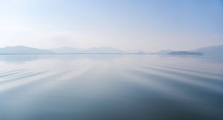calm water: Calm river, idyllic landscape. Soothing water background.