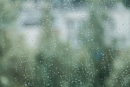 Rain drops on window closeup. Soothing background.