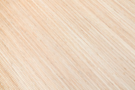diagonally: Brown wooden background of bamboo boards. Texture.