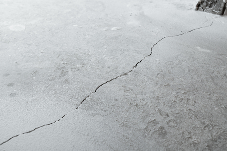 shrinkage: Crack in cement floor from shrinkage of house. The problem of construction. Background.