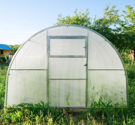 Greenhouse made of polycarbonate in the garden