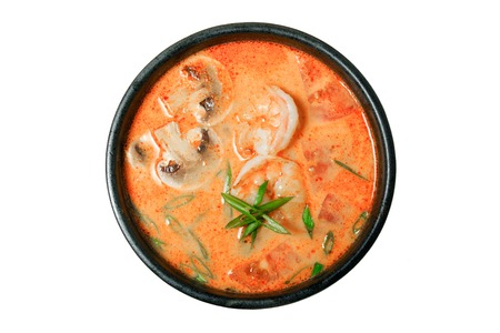 Thai soup Tom Yam Kung or Tom Yum with mushrooms and shrimp. Isolated on white background. Menu.