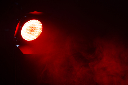 Red light with smoke on dark background. Equipment for photo Studio. Banque d'images - 120779109