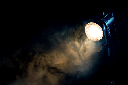 Yellow light with smoke on dark background. Equipment for photo Studio. Banque d'images - 120779112