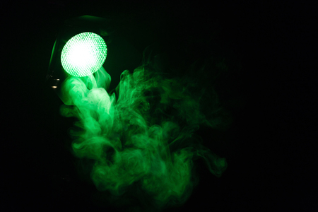 Green light with smoke on dark background. Equipment for photo Studio. Banque d'images - 120779115