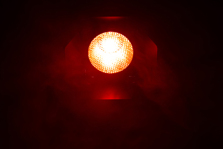 Red light with smoke on dark background. Equipment for photo Studio. Banque d'images - 120779116
