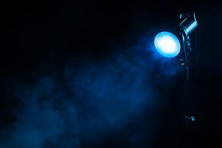 Blue light with smoke on dark background. Equipment for photo Studio. Stockfoto