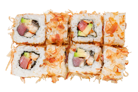 Sushi roll with raw fish, avocado and shavings tuna. Isolated on white background. Japanese cuisine. Stockfoto