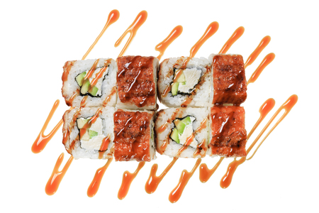 Sushi rolls with sea eel, cheese philadelphia, avocado and sauce. Isolated on white background. Japanese cuisine. Banque d'images - 125394248