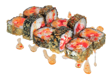 Hot fried sushi roll with cheese, caviar tobiko, sauce and chicken. Isolated on white background. Menu Japanese food.