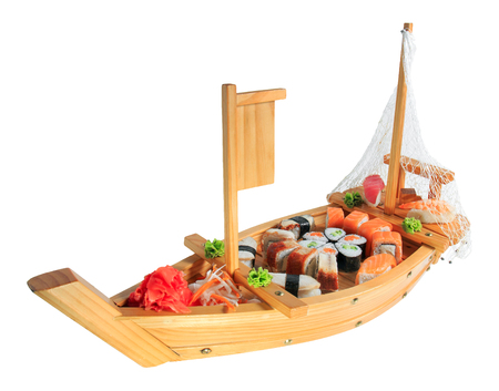 Set of sushi rolls on a wooden ship. Creative serving dishes. Menu. Banque d'images - 125394801