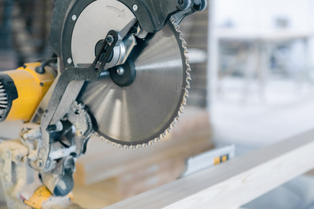 Circular saw in production. Large disc with sharp teeth.