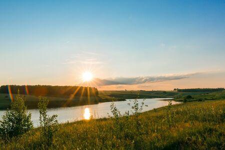 Sunset on the lake. Beautiful peaceful landscape.