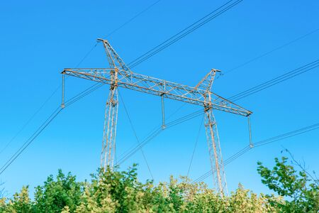 Metallic electrical tower transmitting high voltage. Energy industry Banque d'images - 130710887