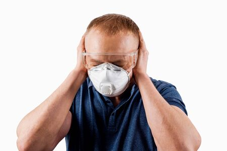Man in a protective mask isolated on a white background. A person in fear and panic before the virus.
