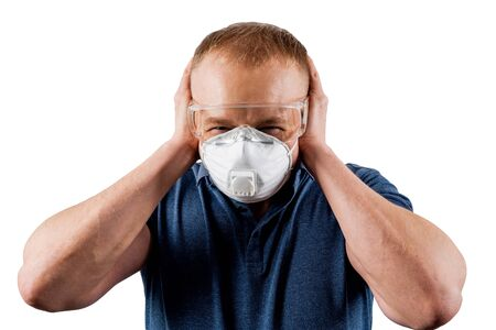 Man in a protective mask isolated on a white background. Sense of panic. Stockfoto