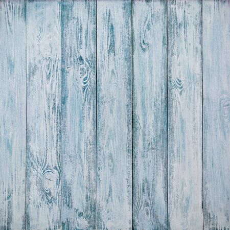 Beautiful wooden background of old weathered boards. Colors are blue and white.