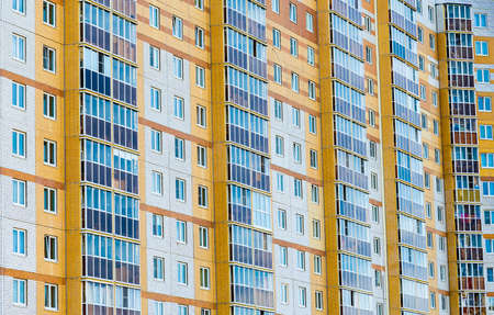 Multi-storey residential building. Construction in Russia. Background.