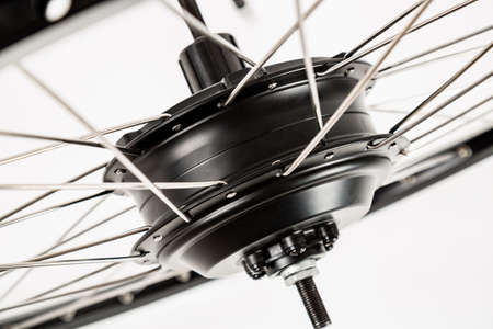 Electric motor close-up. A bicycle wheel.