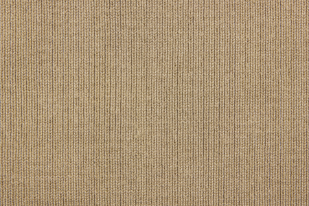 Beige knitted texture for background